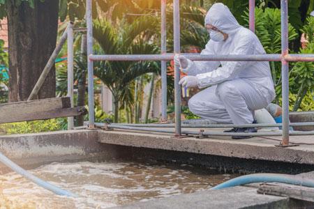USP employee testing wastewater